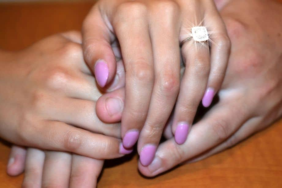 Vibrant Moissy Ring on a Woman's Hand, but Does Moissanite Lose its Sparkle Over Time?